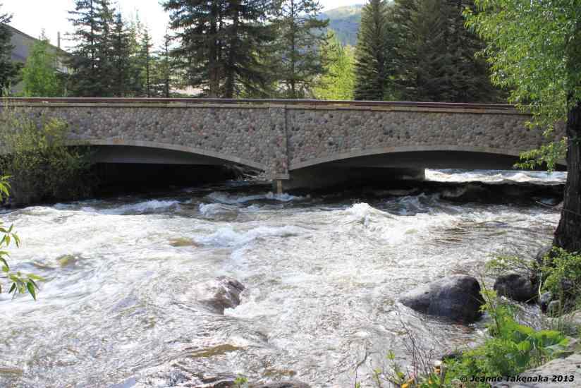 A bridge providing a cross way over a racing river