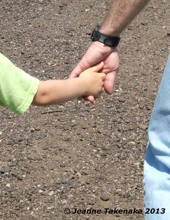Man child holding hands