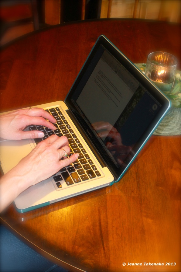 A woman typing on her laptop