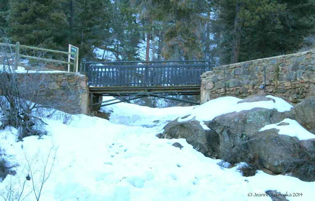 Bridge over frozen falls