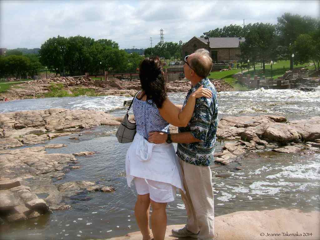 A couple near a river