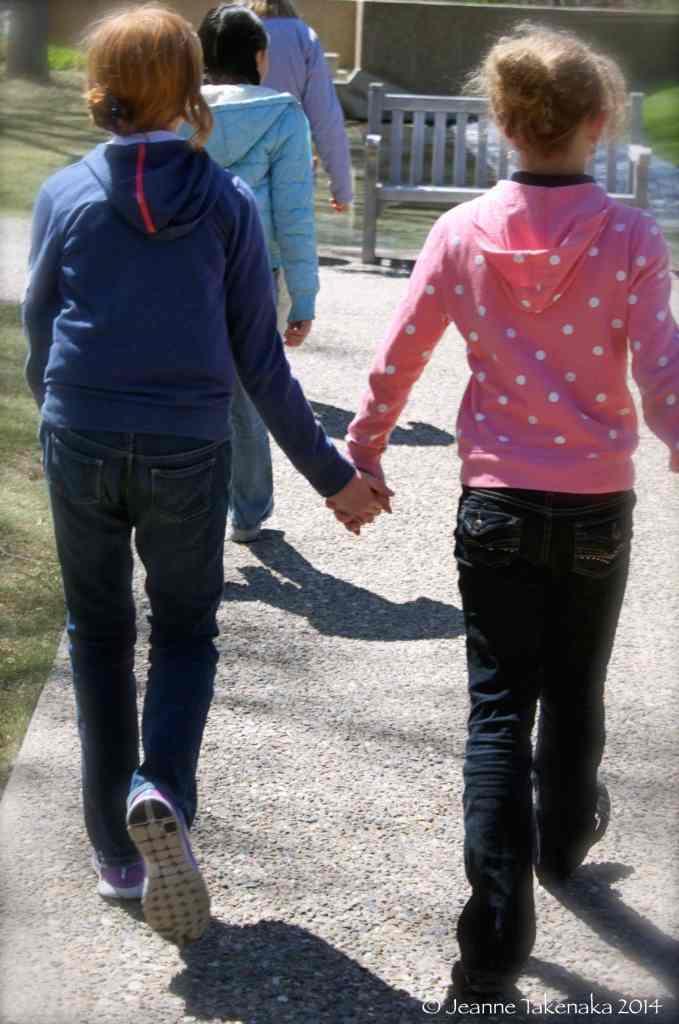 Girls hand in hand