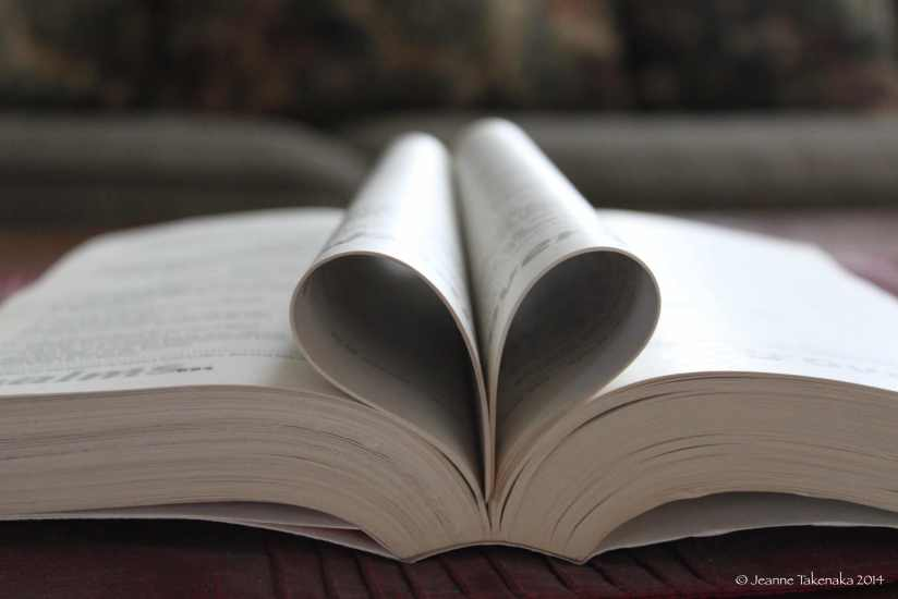a bible with the pages forming a heart
