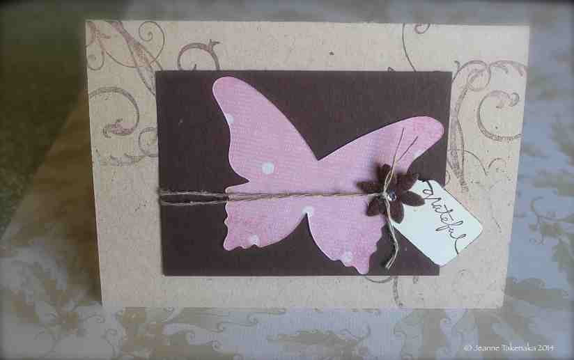 "A greeting card with a butterfly on it and the word, ""Grateful."""