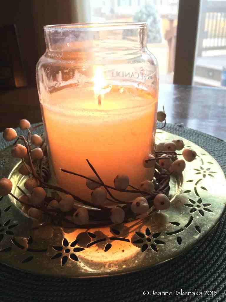 Candle on gloomy day