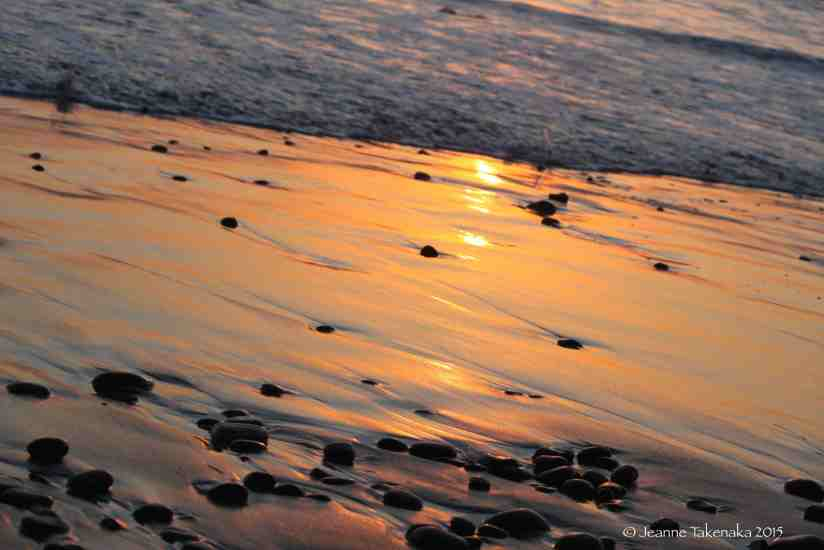 Beach stones at sunset