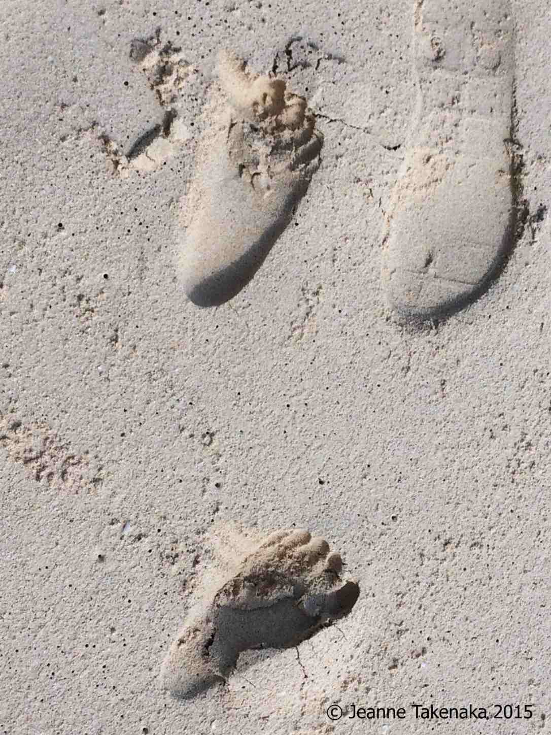 Big-small feet in sand