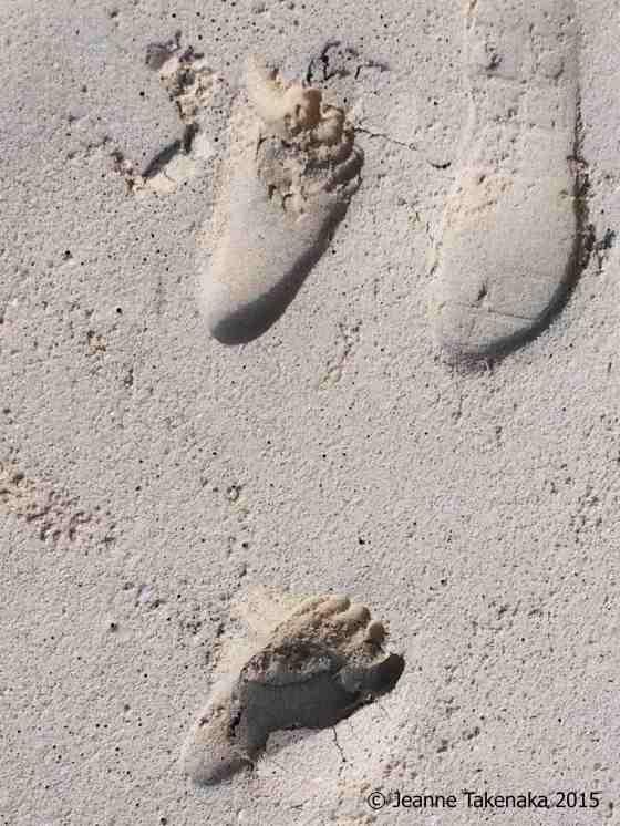 Big-small feet in sand
