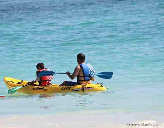 Father son kayak on ocean