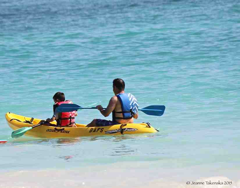Father son kayak on ocean