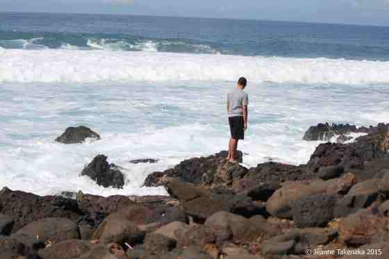 Young man and waves