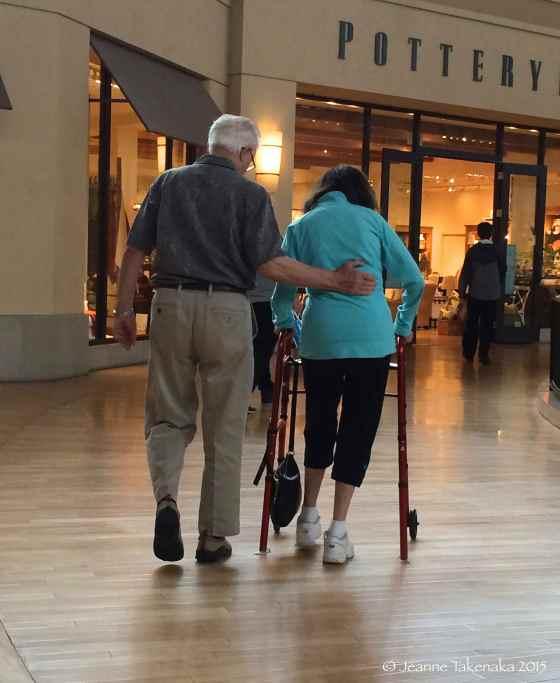 Man helping wife