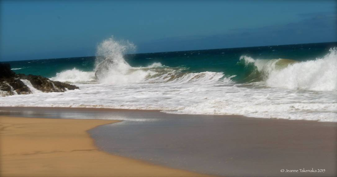 Waves crash against rock