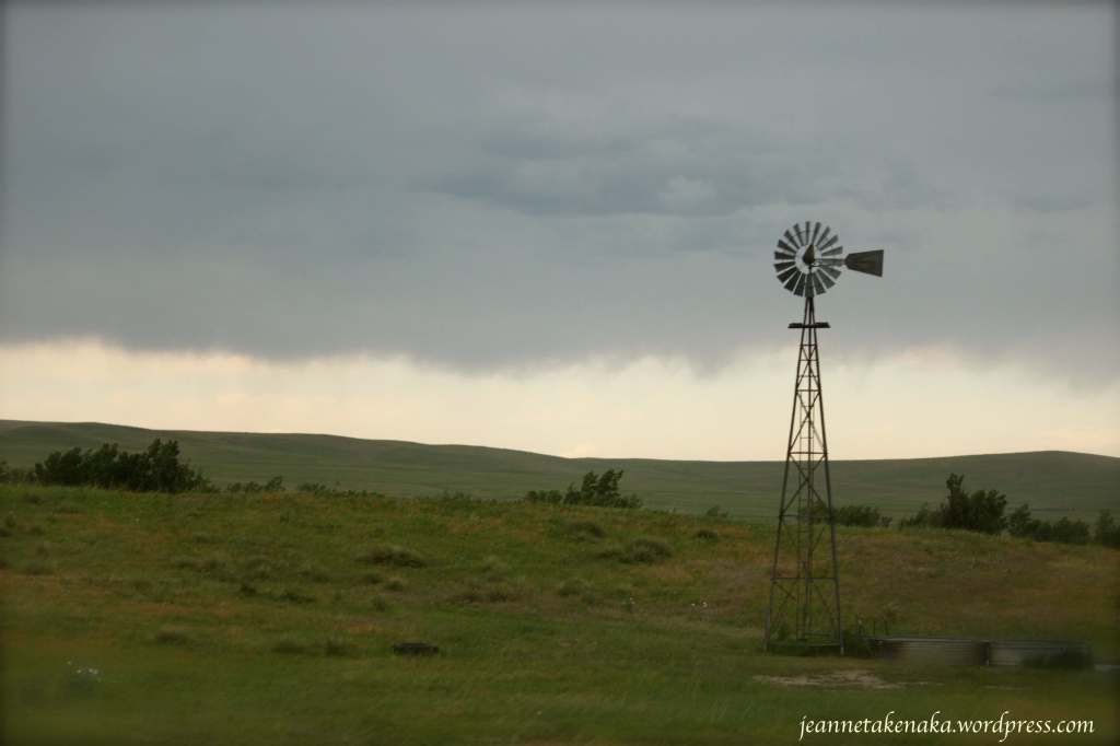 Windmill and stormy sky