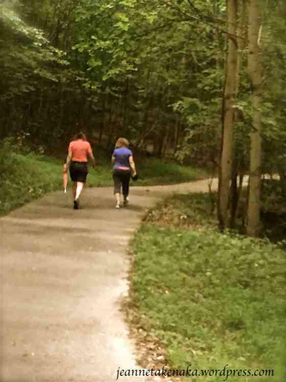 Two women walking ahead