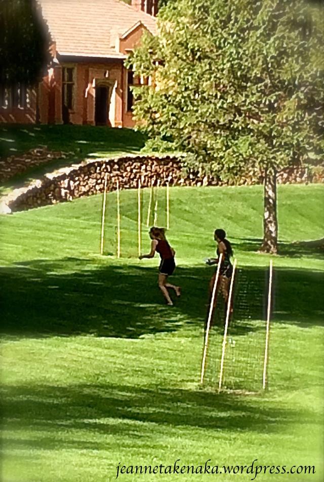Girls playing frisbee