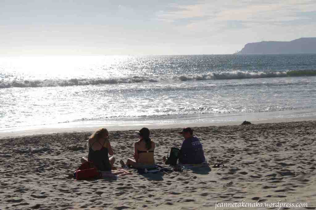 sitting-on-the-beach-friends