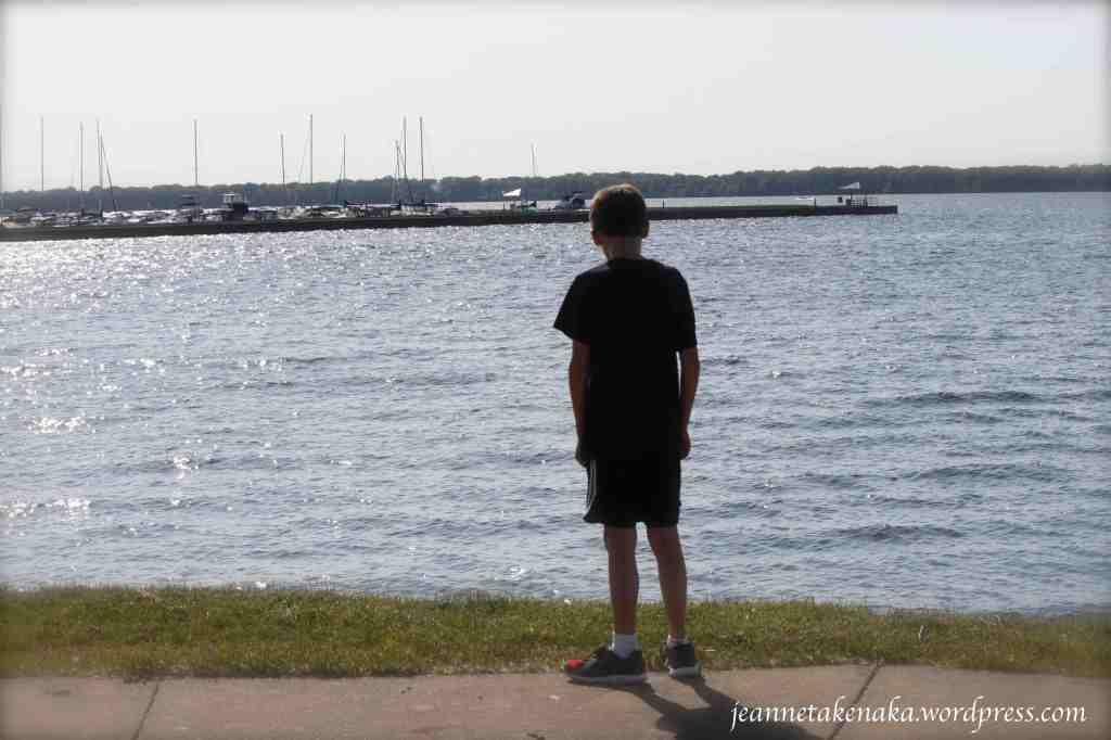 boy-looking-at-lake
