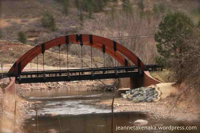 A bridge spanning a river in the mountains