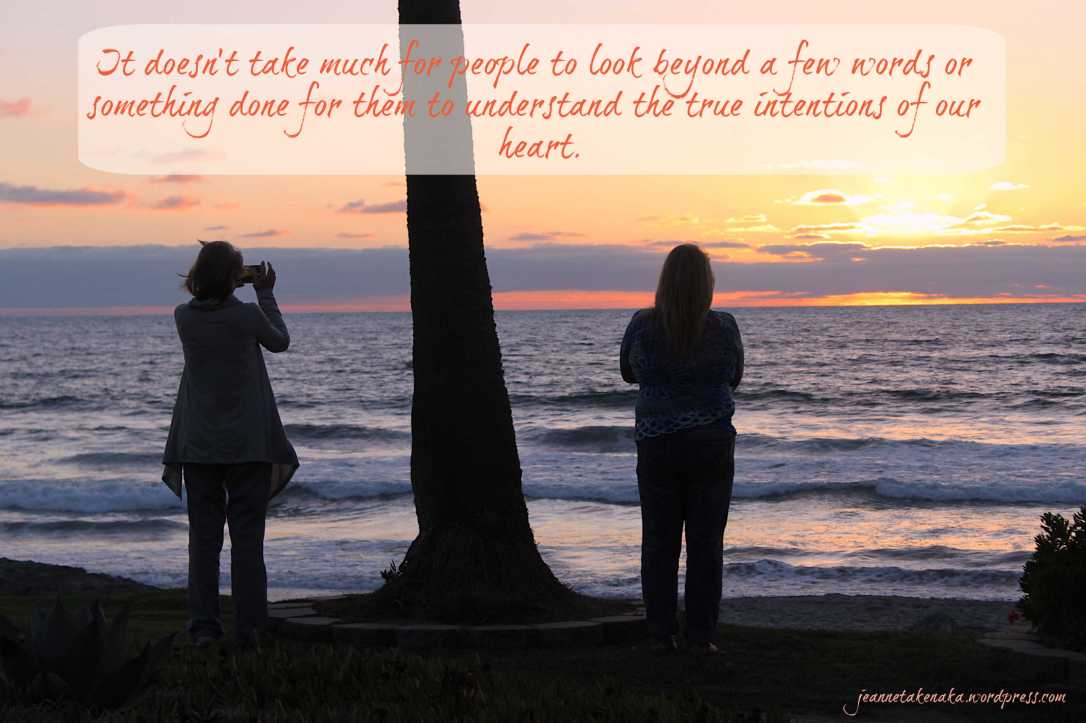 "Meme with two women facing the ocean at sunset...says ""It doesn't take much for people to look beyond a few words or something done for them to understand the true intentions of our heart."""