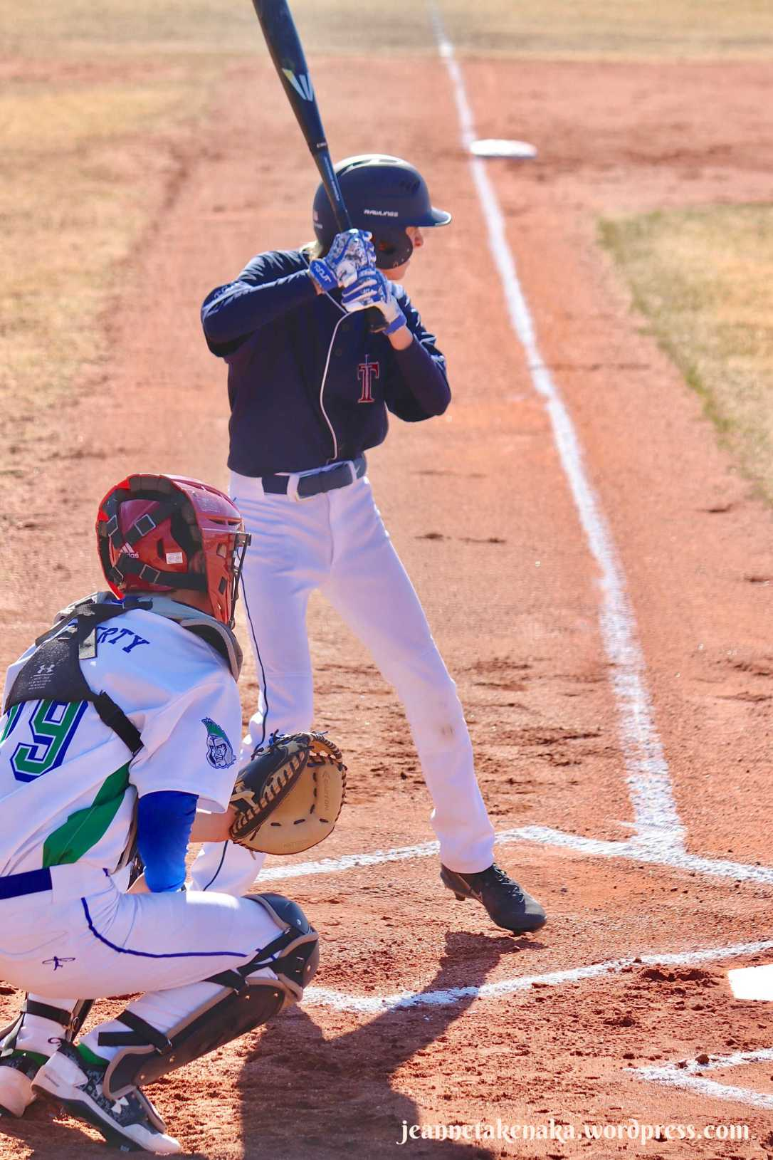 Perspective: Boy at home plate in batting position