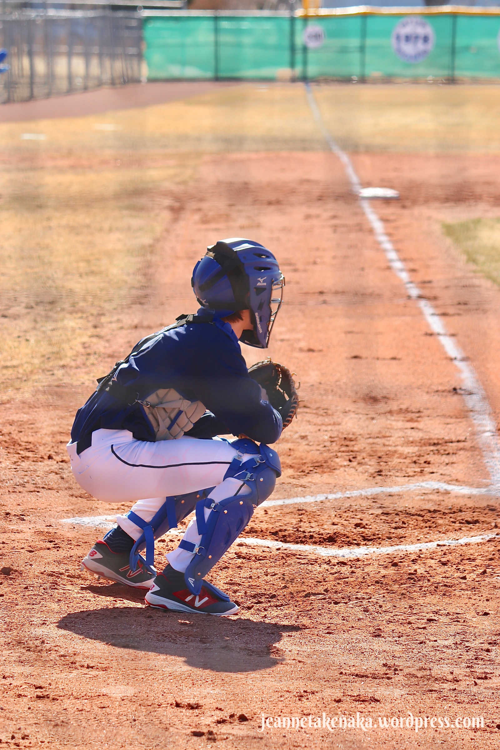 Perspective: Baseball catcher in position waiting for the pitch