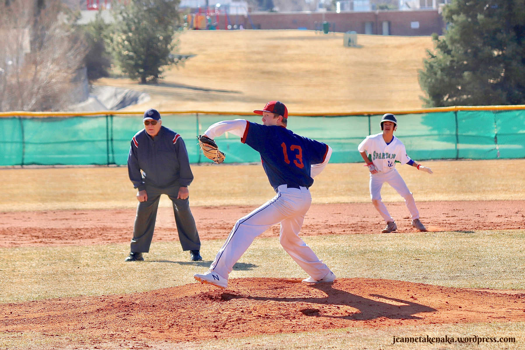 Perspective: Pitcher in motion pitching a baseball