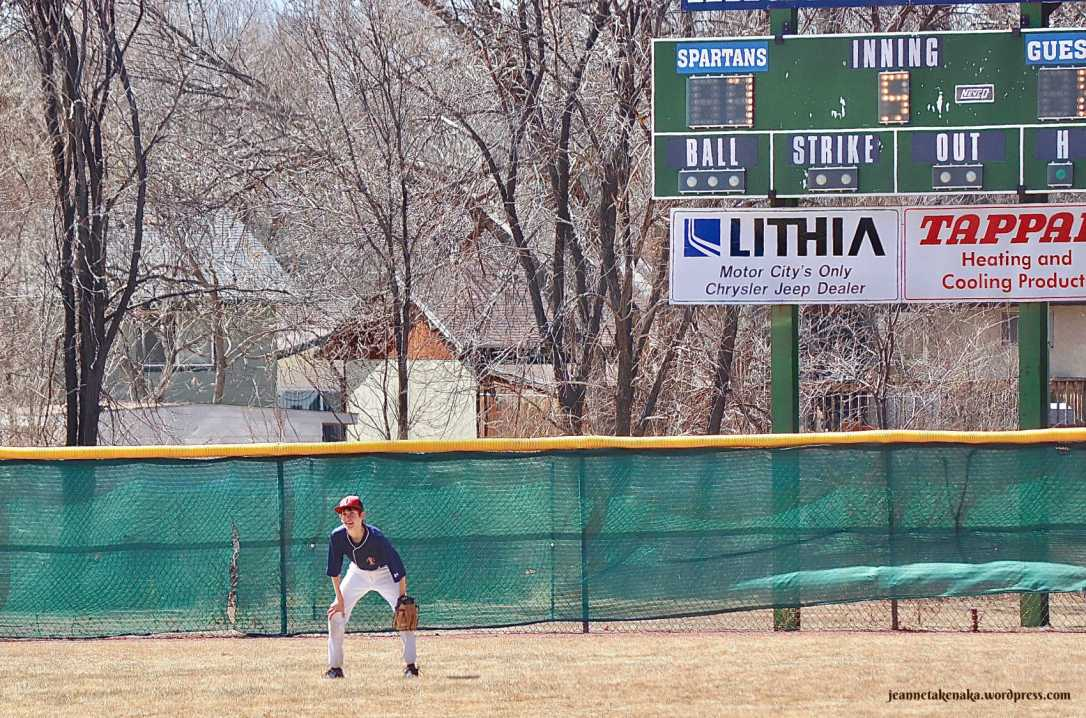 Perspective: Boy in right field anticipating a baseball