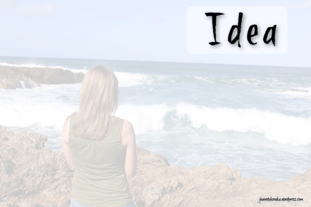 "A photo from the back of a woman gazing toward the ocean with the word ""Idea"""
