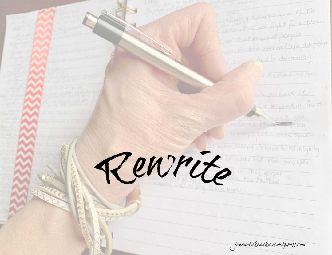 Meme with the word Rewrite imposed over a picture of a hand holding a pen and writing