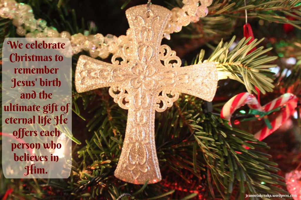 "Meme that says, ""We celebrate Christmas to remember Jesus' brith and the ultimate gift of eternal life He offers each person who believes in Him."" on a backdrop with a cream colored cross hanging on a tree."