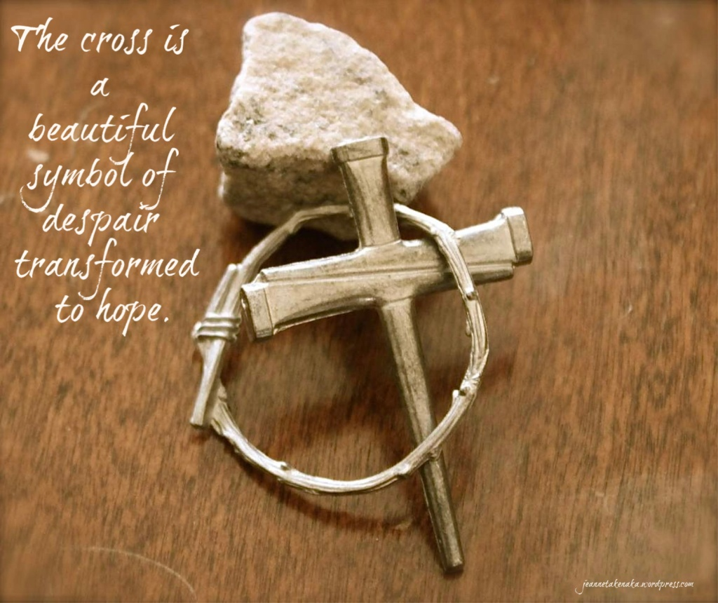 "Meme with the words: ""The cross is a beautiful symbol of despair transformed to hope"" on an image of a small rock, a metal crown of thorns and a metal cross on top of each other"
