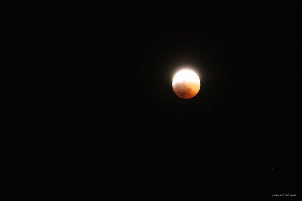 Picture of a black sky and a red moon during an eclipse