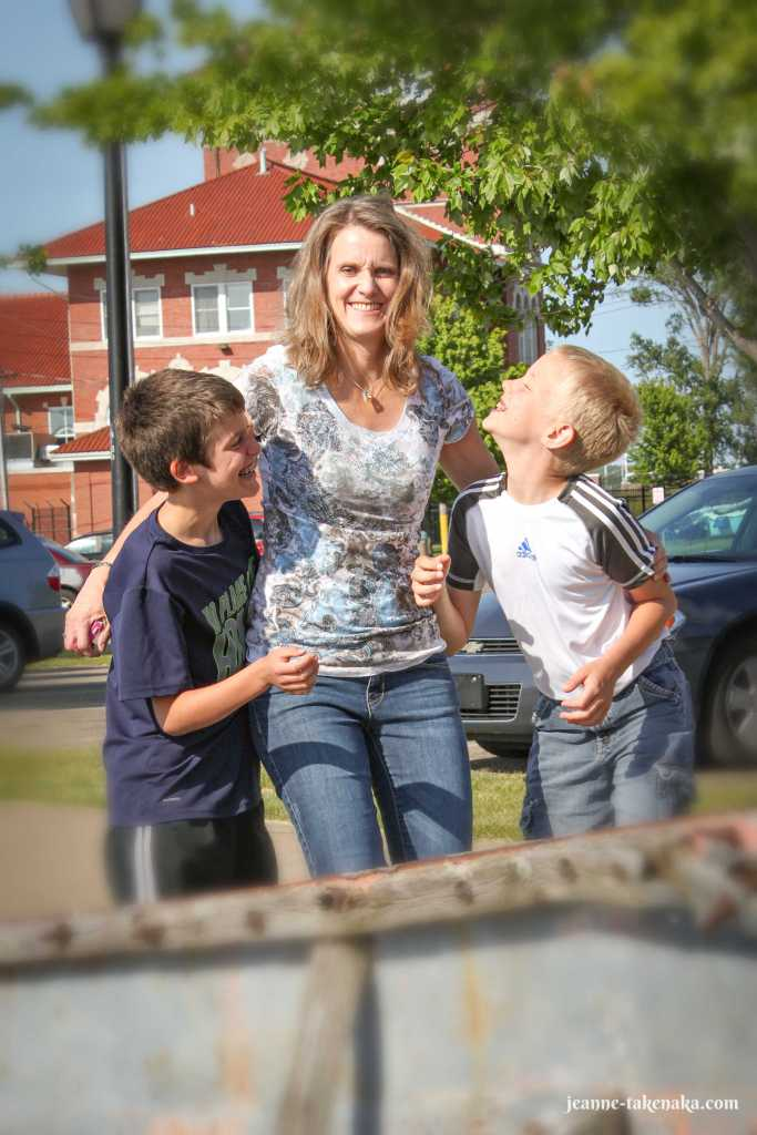 A woman with her two sons in a silly moment
