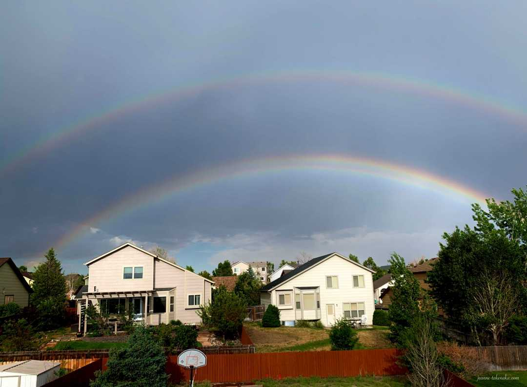 A photo of a double-rainbow after a summer rain